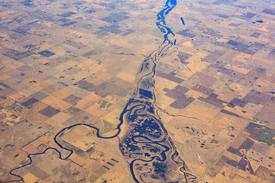 river and field near Minot and Logan, United States