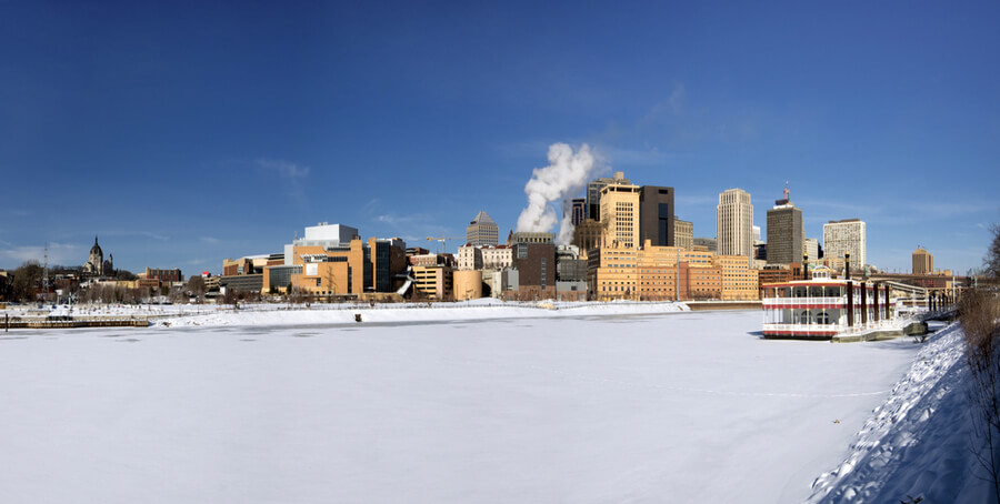 ice covered Mississippi River with Saint Paul skyline
